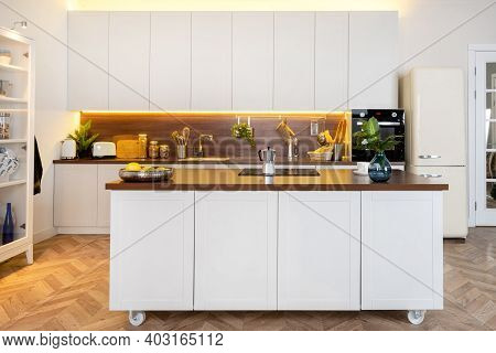 Domestic Life And Household Equipment Concept. Front View Of Contemporary Interior With White Kitche