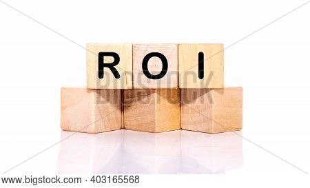 Return On Investment, Roi. A Cubic Wooden Block With An Alphabet Building The Word Roi. Isolated