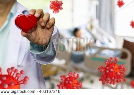 Doctor Hold Red Heart And Concept Model Covid 19 Or Coronavirus Case Of Respiratory Epidemic Damage