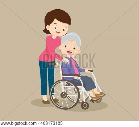 Elderly Woman Sit In A Wheelchair And The Daughter Tenderly Puts  Hands On Her Shoulders.daughter Ca