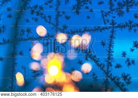 Blurred Blue Background With Bright Bokeh.christmas Card. Shine Of Light. Beautiful Bright Holiday A