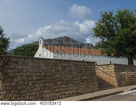 View Of Old White Red Roof Church Chiesa Di Santa Maria Over Stone Wall In Small Coastal Village San