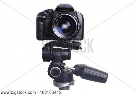 Digital Photo Camera On Black Tripod Isolated On White Background