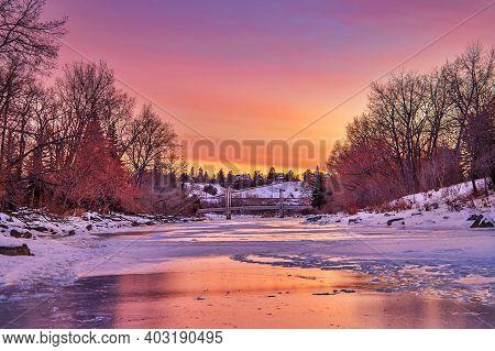 Bright Sunrise Sky Over A Wintry Calgary Park