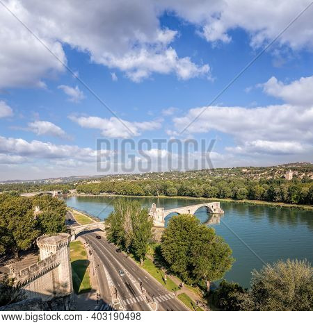 Avignon, Famous Bridge With Rhone River Against Blue Sky In Provence, France