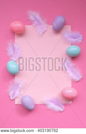 Easter Holiday. Easter Card Blank.pink And Blue Easter Eggs, Lilac Feathers On A Light Pink Backgrou