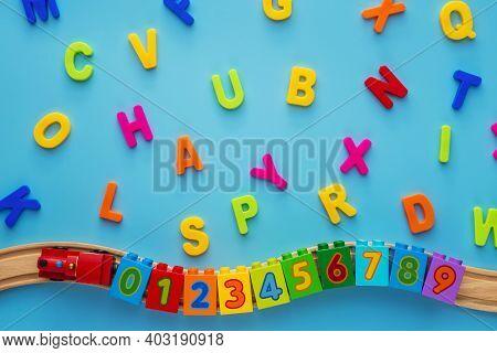 Educational Toys Blocks, Numbers, Letters, Train On Blue Background. Toys For Kindergarten, Preschoo