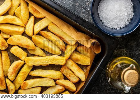 Big french fries. Fried potato chips. Top view.