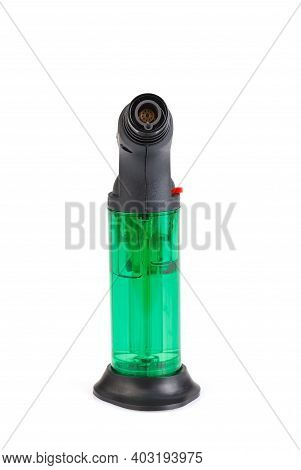 Clear Green Plastic Gas Lighter. Gas Lighter Isolated On White Background. Close Up Gas Burner.