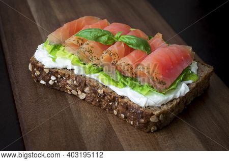 Smoked Salmon Sandwich With Fresh Lettuce And Cheese Cream. Healthy Nutrition Receipt.  Sandwich   W