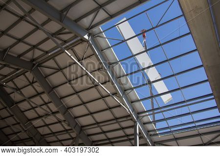 Construction Of A Prefabricated House. Steel Frame Of The Building And Insulating Panels For The Lec