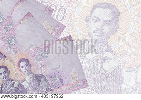 500 Thai Baht Bills Lies In Stack On Background Of Big Semi-transparent Banknote. Abstract Business