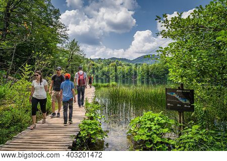 Plitvicka Jezera, Croatia, July 2019 Tourists Walking On Boardwalk In Stunning Plitvice Lakes Nation