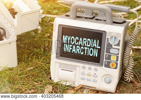Medicine And Health Concept. The Text Is Written On The Defibrillator Monitor - Myocardial Infarctio