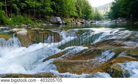 Beautiful View Of The Rock Cascades And Waterfalls On The River In Mountains