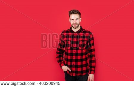 Young Handsome Man In Checkered Shirt Has Bristle On Face, Fashion