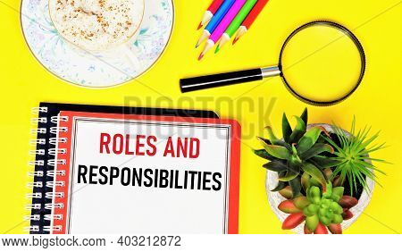 Roles And Responsibilities. Text Label In The Planning Notebook. The Concept Of Effective Implementa
