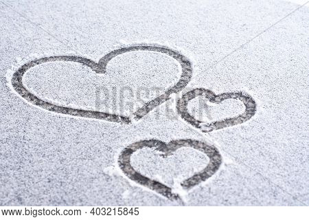 The Image Of The Heart In The Snow. Valentine Day Background. I Love Winter Or St.valentine's Day Ro