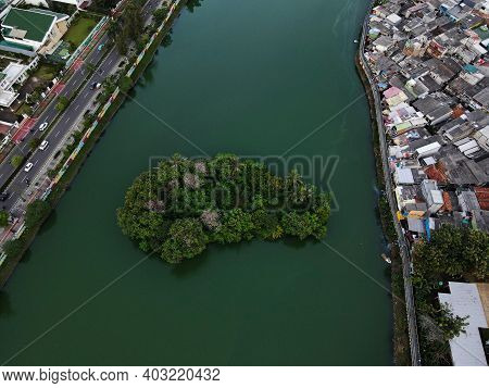 Aerial Drone View Of Beautiful Residential Area And Green Lake With Jakarta Cityscape. Jakarta, Indo