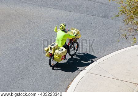 Perth, Australia - September 24, 2020: Postman On A Bicycle Working For Australia Post