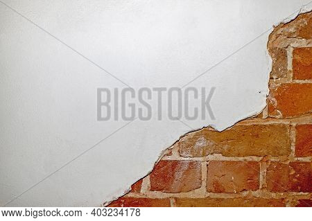 Part Of The Red Brick Wall Of An Old House With A Figured Pattern Of White Putty. Background, Contra