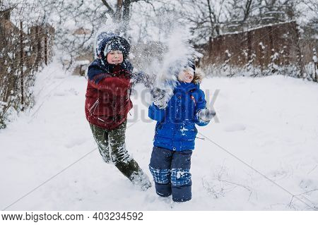 Outdoor Winter Activities For Kids. Kids Playing In The Suburbs, Winter Backyard Gathering. Boys Hav
