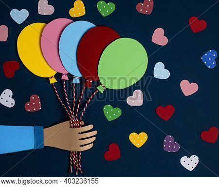 Hand Holding A Bunch Of Colorful Paper Balloons. Balloons Party Invitation Card. Celebrate Events Ba