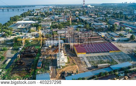 Aerial Top View Of Industrial Park Zone From Above, Factory Chimneys And Warehouses, Industry Distri