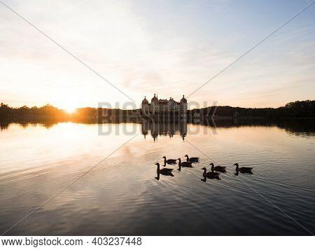 Panorama Sunset Reflection Of Schloss Moritzburg Baroque Castle On Schlossteich Lake Island In Saxon