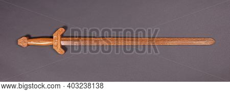 Chinese Wooden Sword Isolated On A Grey Background