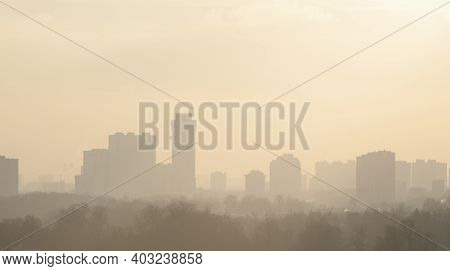 The City Is In A Frosty Haze. Winter Day In The Suburbs.