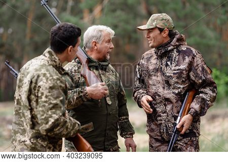 Men With Hunting Rifles Hunters Have Fun Outdoor.