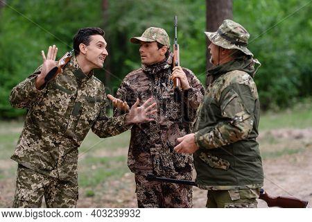 Hunter Telling Story Friends Laugh Hunting Season.