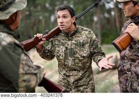 Agressive Young Man Shouts Hunters Got Conflict.