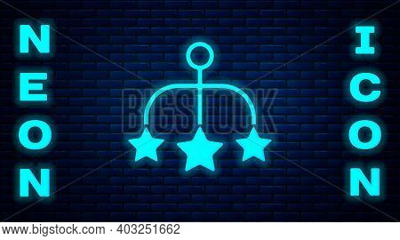 Glowing Neon Baby Crib Hanging Toys Icon Isolated On Brick Wall Background. Baby Bed Carousel. Vecto