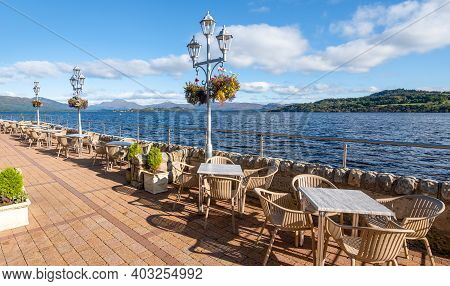 Looking Out Over Loch Lomond From Duck Bay Marina In Scotland On A Sunny Day With A Blue Sky