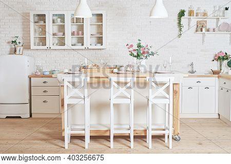 White Kitchen In Interior Loft Style. Valentine's Day Kitchen Decor. Kitchen Utensils And Shelves.