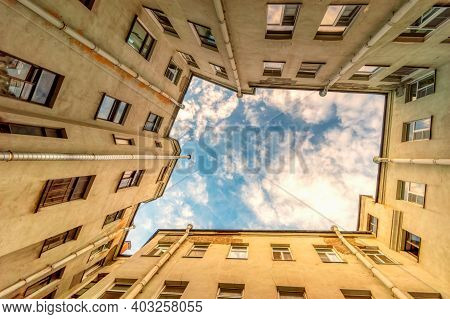 Ancient High-rise Courtyards Of The Sky Of St. Petersburg.a Typical Courtyard In The Old District Of