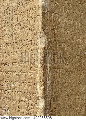 Inscriptions On The Ancient Temple Stone Walls. Ancient Stone Carving. Old Stone Wall Texture. Tamil