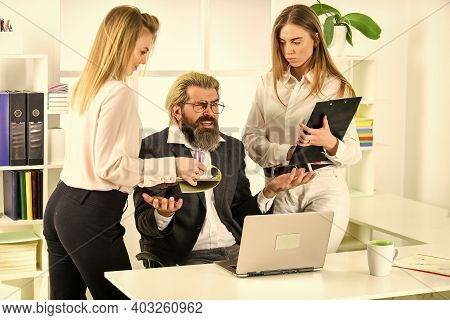 Angry Boss Is Surrounded By Assistants. Women And Man Discuss Work Issues. Colleagues Brainstorming
