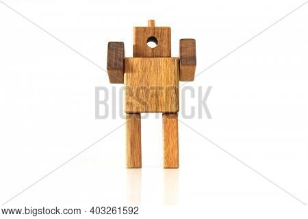 Hand made wooden robot craft on white background