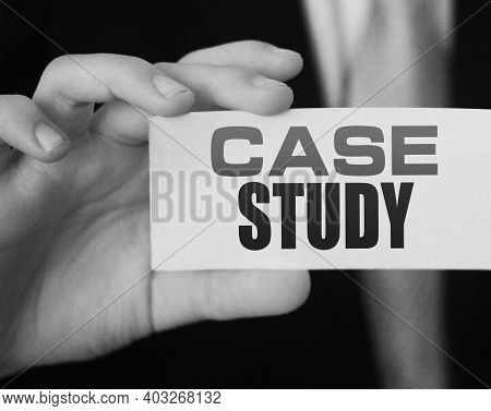 Case Study, Message On White Card In Hand Of Businessman.