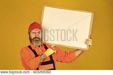 Businessman. Male Construction Worker. Man With Presentation. Builder Points To Flipchart. Copy Spac
