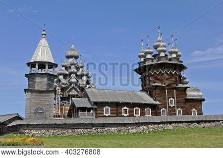 Kizhi, Russia - 14 July 2014: Kizhi Pogost. View Of The Belfry, Church Of The Transfiguration And Ch