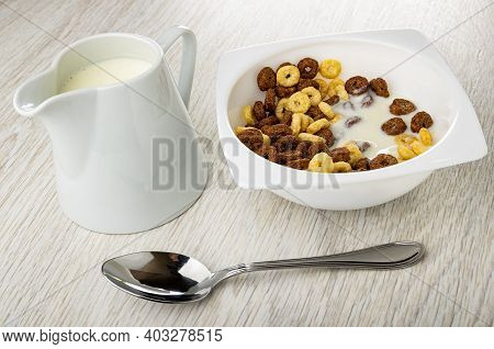 Pitcher With Yogurt, Toasted Cereal Breakfasts With Yogurt In White Bowl, Spoon On Wooden Table