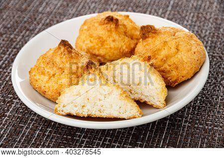 Few Coconut Cookies, Halves Of Cookies In White Saucer On Dark Mat