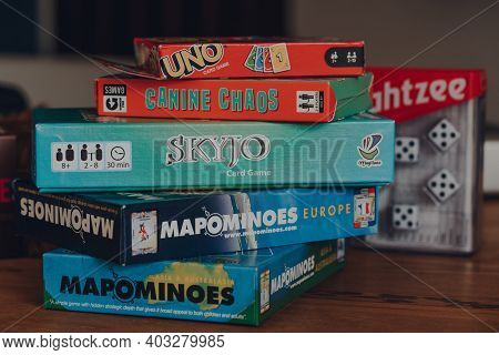 Combe St Nicholas, Uk - July 25, 2020: Stack Of Modern And Classing Board Games On A Table. Sales Of