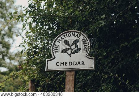 Cheddar, Uk - July 26, 2020: The National Trust Sign At The Entrance To Cheddar, A Village Famous Fo