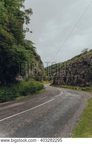 Road Going Through Cheddar Gorge In The Mendip Hills, Near The Village Of Cheddar, Somerset, England