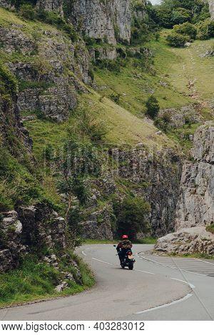 Cheddar Gorge, Uk - July 26, 2020: Road Going Through Cheddar Gorge Limestone Gorge In The Mendip Hi